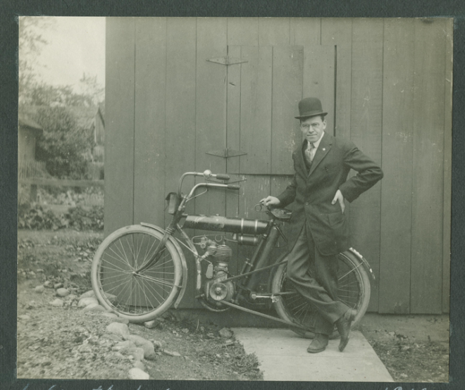 D.J. Angus with ca. 1910 motorcycle he rode from Lafayette, Indiana to Niagara Falls, New York.
