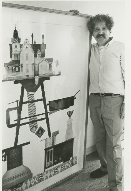Mike McDonnell standing next to his art.