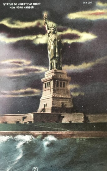 [Postcard front] Statue of Liberty at Night; New York Harbor