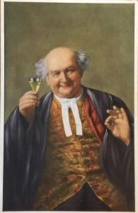 [Postcard front] A plump, bald man in a gold vest raises a glass of wine