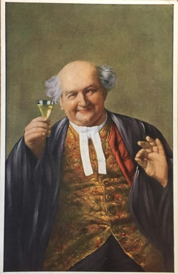 [Postcard front] A plump, bald man in a gold vest raises a glass of wine